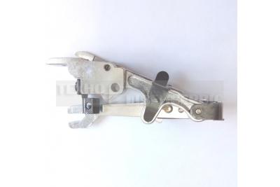 Механизм обрезки края ткани
